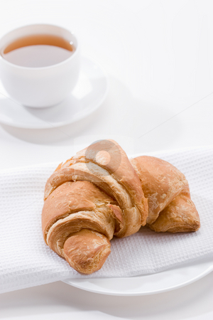 Roll for tea stock photo, Food series: cup of tea and croissant by Gennady Kravetsky