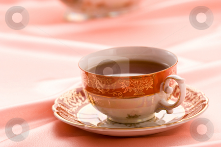 Cup of tea  stock photo, Pink still life with cup of tea by Gennady Kravetsky