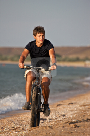 Sea cyclist stock photo, People series: summer portrait cyclist man on bicycle by Gennady Kravetsky