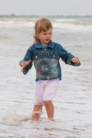 Girl stock photo, People series: little girl on the beach by Gennady Kravetsky