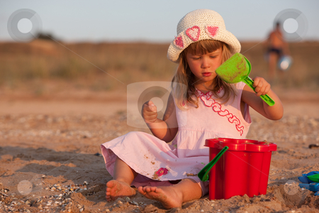 Play the game stock photo, People series: little girl in bonnet are play the game by Gennady Kravetsky