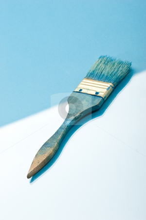 Brush stock photo, Blue paint brush on the blue background by Gennady Kravetsky