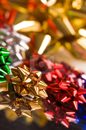 Christmas knot stock photo, Holiday series: Christmas gift red and golden knot by Gennady Kravetsky