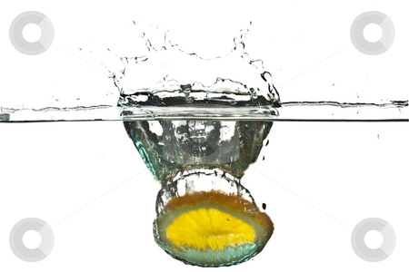 Splash stock photo, Splash, water drops and an lemon in water by Gennady Kravetsky