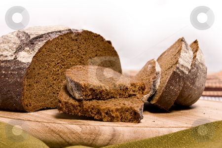 Brown bread stock photo, Food series: round of brown tasty bread by Gennady Kravetsky