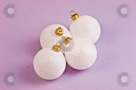 Christmas balls stock photo, Four white balls on the violet background by Gennady Kravetsky