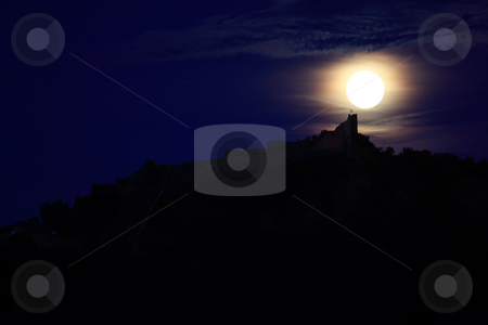 Silhouette stock photo, A full moon is above a castle by ARPAD RADOCZY