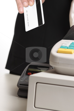 Retail purchase with card stock photo, A man hands his credit or eftpos debit card or a store card at checkout for payment.   Focus to card, shallow dof.  Information has been removed from card You could insert your own card instead by Leah-Anne Thompson