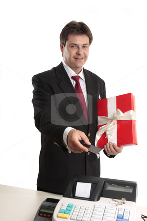 Man paying for persent with card stock photo, A man pays for a present with card at the checkout. by Leah-Anne Thompson