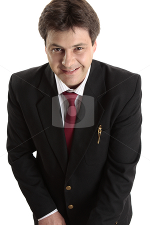 Businessman looking up smiling stock photo, Businessman or salesman in a black suit looks up and smiles cheerfully. by Leah-Anne Thompson