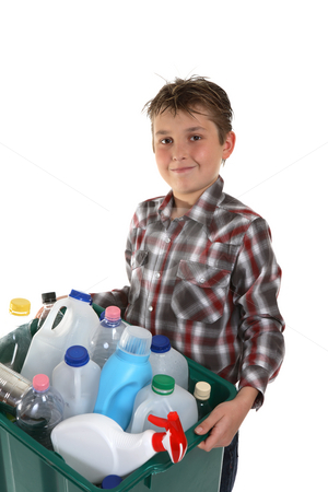 Child carrying recycling stock photo, A child carrying a plastic container full with empty recyclable household material. by Leah-Anne Thompson