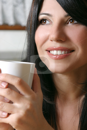 Coffee Break stock photo, A woman leisurely relaxes with a hot beverage. by Leah-Anne Thompson