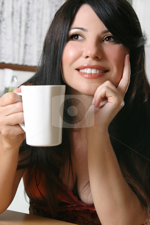 Woman with a mug of coffee stock photo, Woman sitting down with a cup of hot coffee by Leah-Anne Thompson