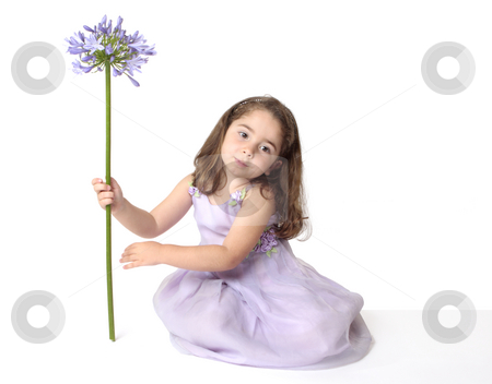 Serene girl with flower stock photo, Serene girl in mauve dress holding a beautiful purple agapanthus flower.  You may swap the flower for a balloon or any other object. by Leah-Anne Thompson