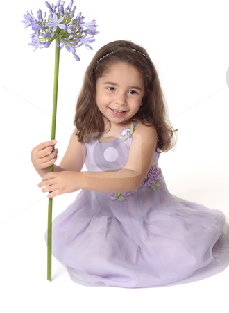 Pretty girl holding flower stock photo, Pretty smiling girl holding a purple flower. by Leah-Anne Thompson