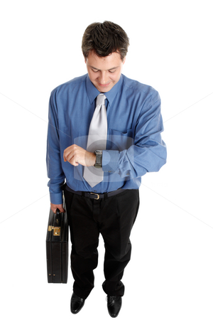 Businessman checking time stock photo, Businessman holding a briefcase checks the time by Leah-Anne Thompson