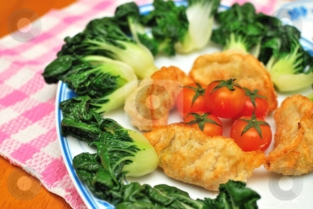 Chinese dumplings and vegetables stock photo, Sumptuous looking Chinese style fried vegetarian dumplings and vegetables. Suitable for concepts such as diet and nutrition, healthy eating and healthy lifestyle, and food and beverage. by Wai Chung Tang