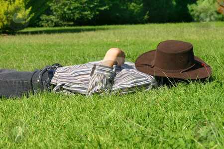 Child asleep in the grass stock photo, A child lays in grassy field taking a rest or siesta. by Leah-Anne Thompson