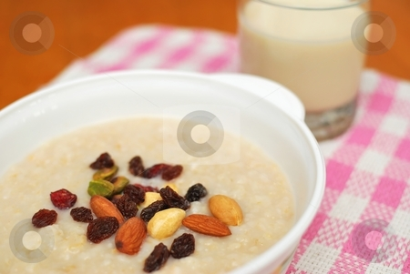 Healthy cereal and soya bean milk stock photo, Cereal and soya bean milk for a healthy and nutritious breakfast. Topped with an assortment of nuts and raisins. Suitable for diet and nutrition, healthy eating and lifestyle, and food and beverage concepts. by Wai Chung Tang