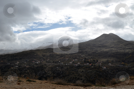 Two Mountains stock photo, A Village in Lebanon with Two mountains covered with snow by Tony Abdou