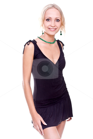 Woman in a black dress stock photo, Woman in a black dress posing on a white background by Artem Zamula