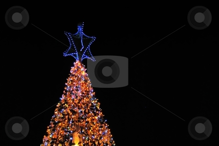 Christmas tree lights isolated on black stock photo, Christmas tree lit up with decorations and colorful lights. Suitable for winter seasons, christmas and holiday concepts. by Wai Chung Tang