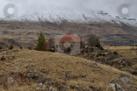Lonely House stock photo, A deserted house between mountains and valleys and snow threatened it by Tony Abdou