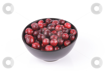 Cranberries in a Black Bowl stock photo, Red ripe cranberries in a small round black bowl with a reflective white background by Keith Wilson