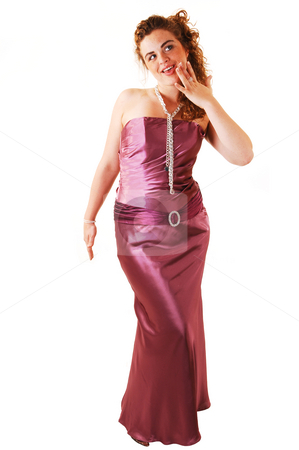 Woman in evening dress. stock photo, Beautiful red haired woman in a long pink evening dress with a pearl necklace and small purse, standing for white background. by Horst Petzold