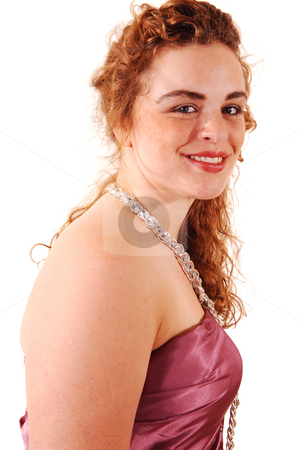 Woman in evening dress. stock photo, Beautiful red haired woman in a long pink evening dress with a pearl necklace in an head shoot, standing for white background. by Horst Petzold