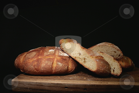 Bread stock photo, Photo of handmade bread on black background by Marina Magri