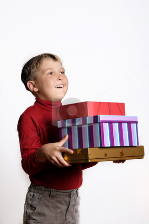 Presents Galore stock photo, Boy holding lots of gifts by Leah-Anne Thompson