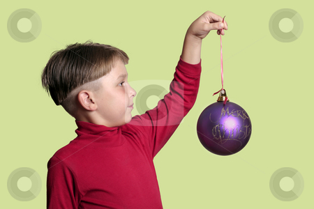 Christmas Bauble stock photo, Child holding a large Christmas bauble by Leah-Anne Thompson