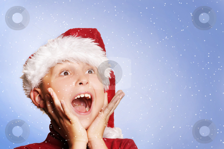 White Christmas stock photo, Excited young boy amongst snowflakes. by Leah-Anne Thompson