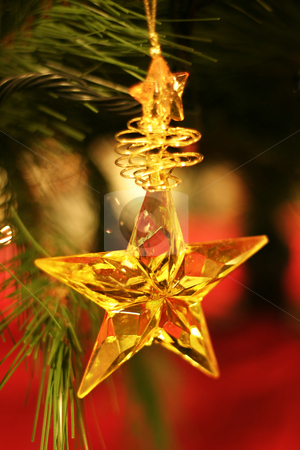 Christmas Star stock photo, Golden star hanging on Christmas tree. by Leah-Anne Thompson