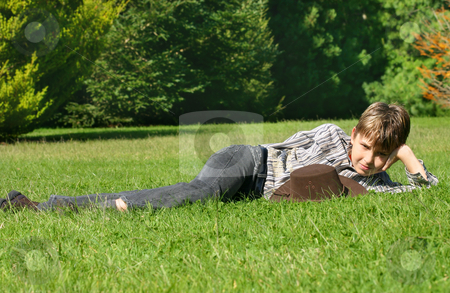 Relaxing in the sunshine stock photo, Relaxing on the grass in the afternoon sunshine by Leah-Anne Thompson