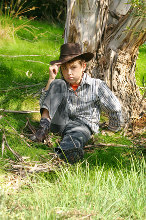 Outback boy in rugged bushland stock photo, A boy in rugged bushland in the outback ranges of Australia by Leah-Anne Thompson