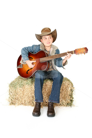 Country music stock photo, A child happily playing an acoustic guitar. by Leah-Anne Thompson