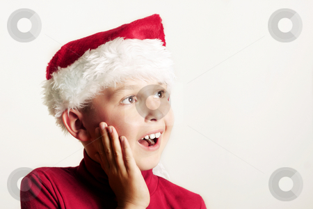 Children - Magic of Christmas stock photo, Gleeful happy child wearing a red Santa hat by Leah-Anne Thompson