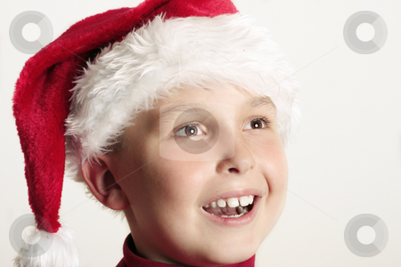 Children - Jolly Christmas Smiles stock photo, An excited boy enjoying Christmas festivities.  closeup by Leah-Anne Thompson