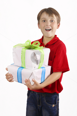 Boy carrying wrapped presents, gifts stock photo, Boy in jeans and red top carrying two gifts. by Leah-Anne Thompson