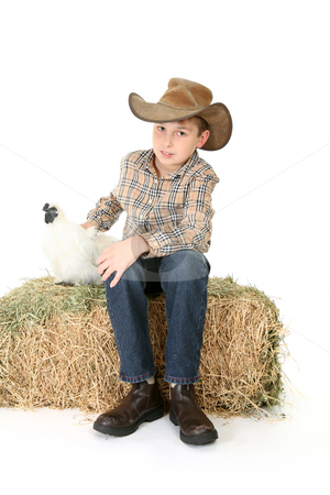 Farmer Boy stock photo, A farm boy sitting on a bale of hay with a pet chicken. by Leah-Anne Thompson