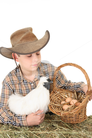 Farm boy with basket of eggs stock photo, A farm boy with a basket of eggs.  Space for copy by Leah-Anne Thompson