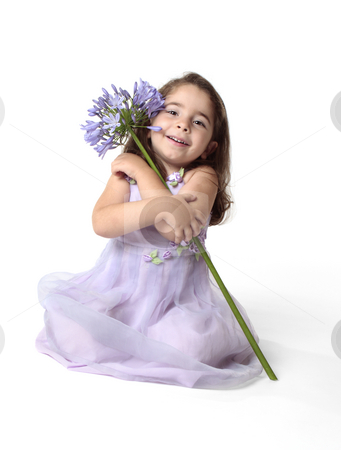 Beautiful smiling girl with pretty flower stock photo, Little girl arms wrapped around a large agapanthus lily flower. by Leah-Anne Thompson