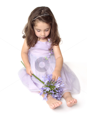 Little girl playing stock photo, Little girl playing with a flower - above view by Leah-Anne Thompson