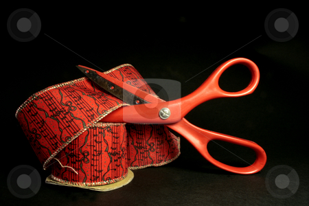 Scissors and ribbon stock photo, Red scossors and red ribbon ob black background by Marina Magri