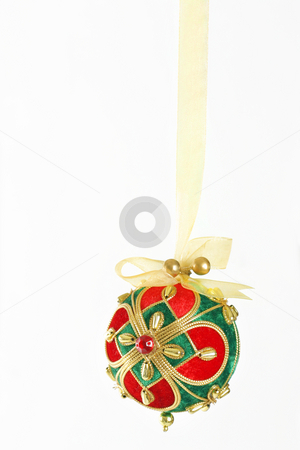 Bejewelled Christmas Bauble stock photo, A decorative Christmas ball tied and hanging with gold organza  ribbon by Leah-Anne Thompson