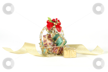 Basket of Gifts stock photo, Basket of decorative gifts on white background by Leah-Anne Thompson