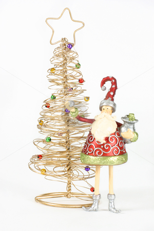 Golden tree and Santa Elf stock photo, Two Christmas Decorations - Golden tree with decorative baubles and santa elf decoration on white background. by Leah-Anne Thompson