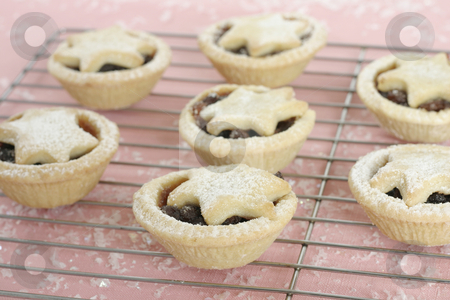 Fruity mince pies stock photo, Fruity mince tarts on cake cooler, focus on foreground. by Leah-Anne Thompson